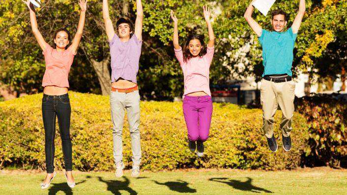 pupils jumping for joy