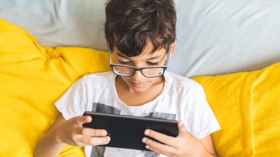 child with tablet at home