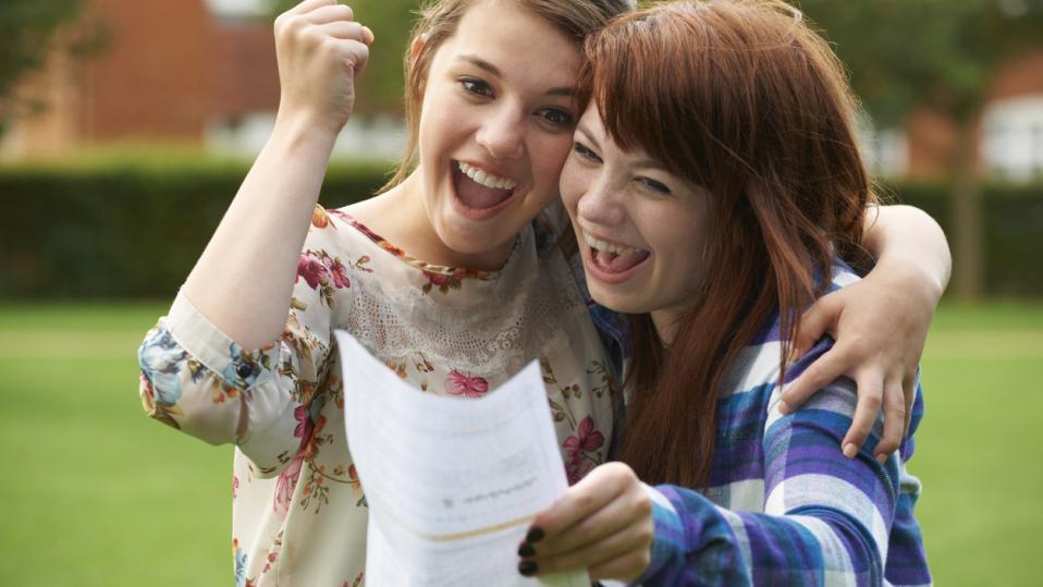 Girls receiving exam results