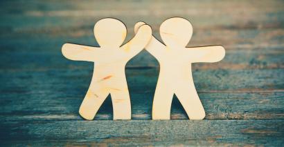 Wooden Little Men Holding Hands, Symbolizing Collaboration & Partnership.