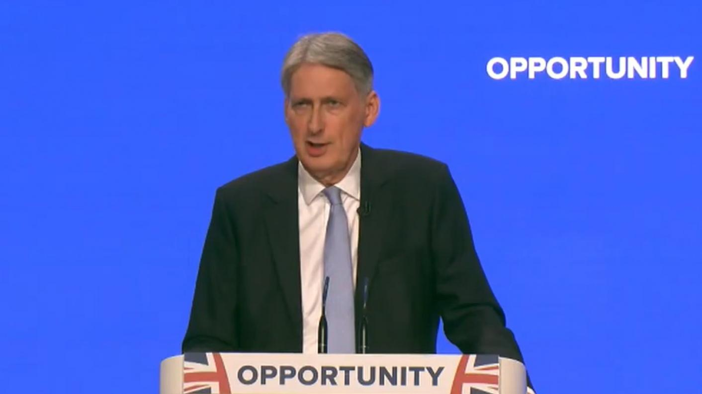 Philip Hammond told the Conservative Party Conference in Birmingham the government will set aside £100 million for a national retraining scheme