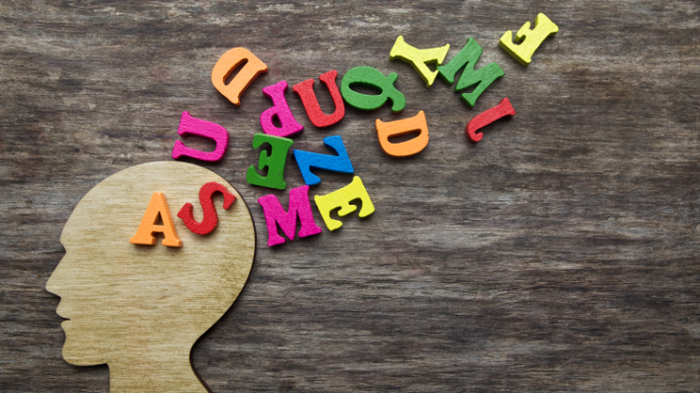Dyslexia: letters falling out of a person's head