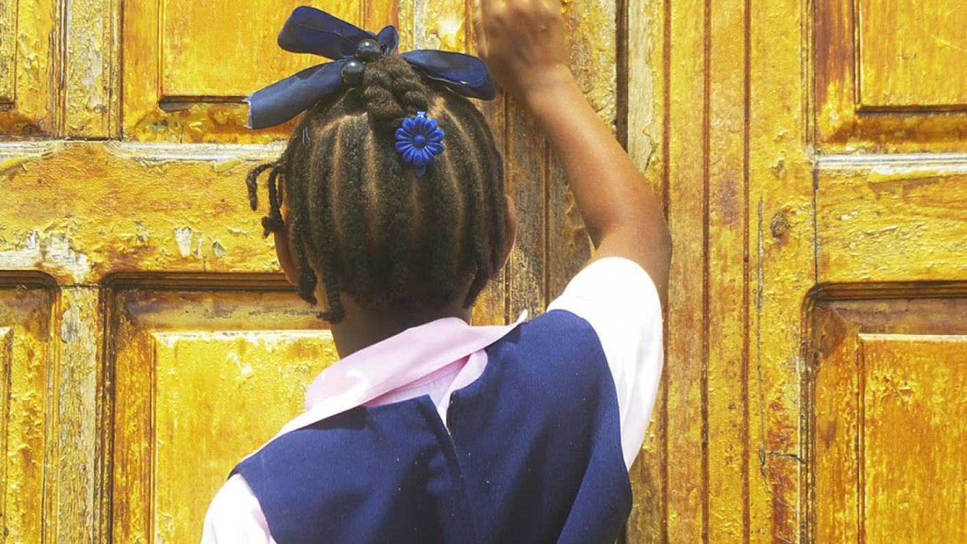 Child knocking on door