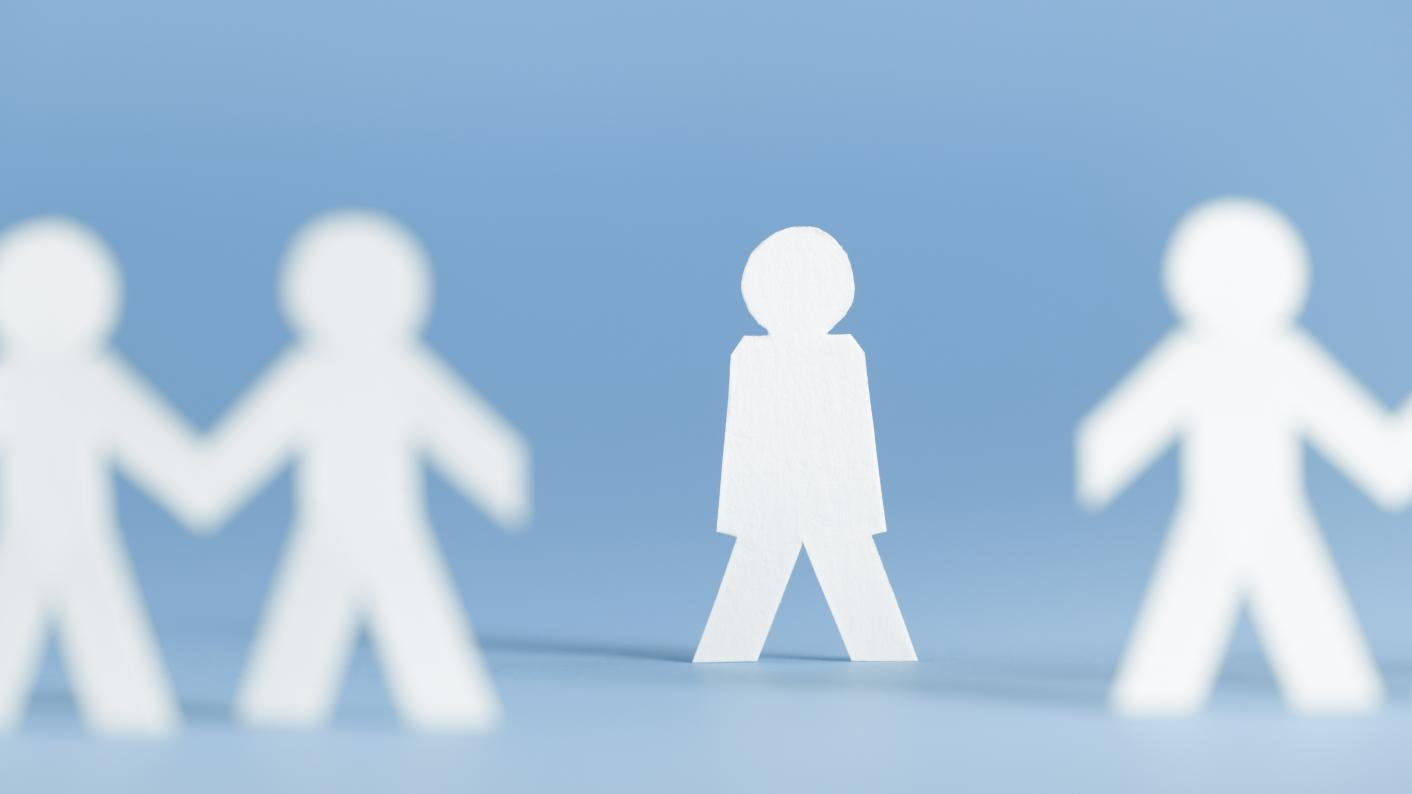 Cut out paper figures with one isolated from group