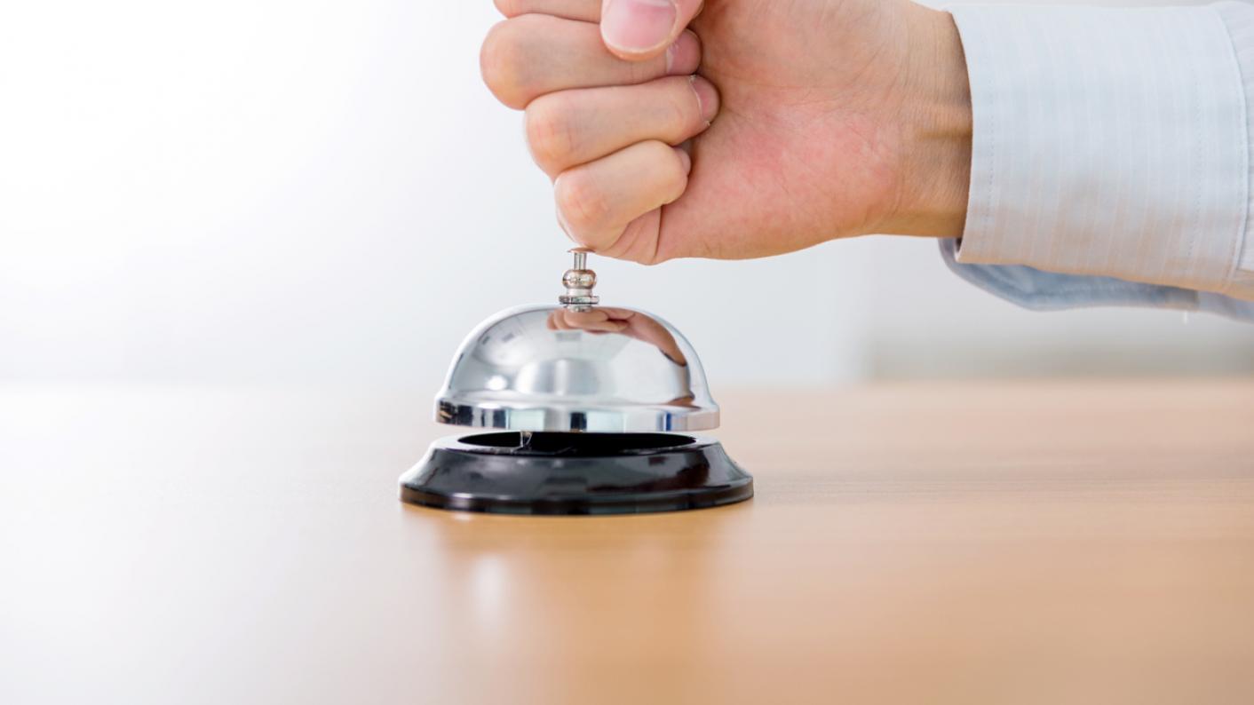 Fist slamming on bell for service