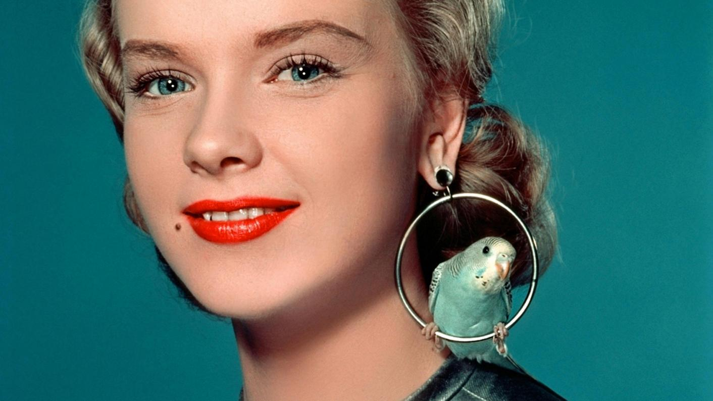 Classic 1950s image of a woman wearing large earrings