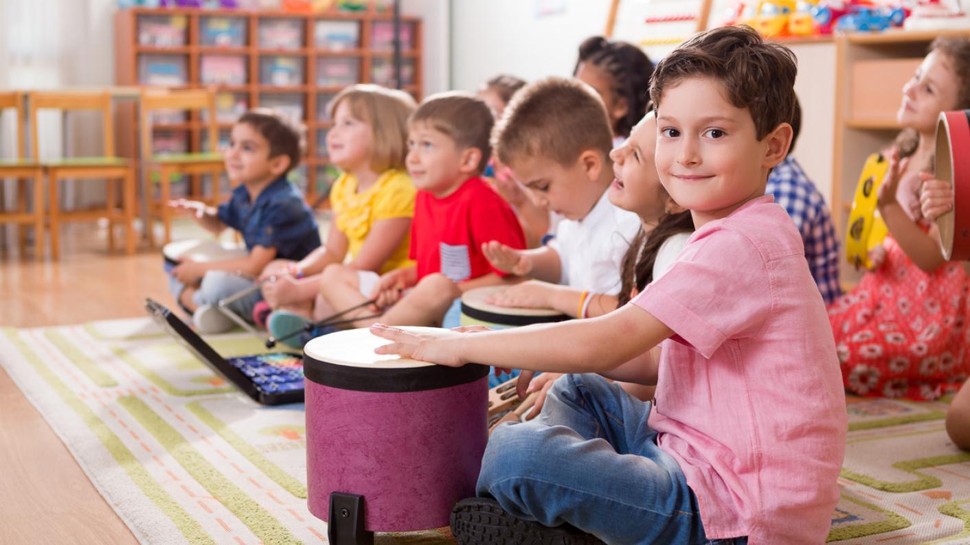 Children in music lesson
