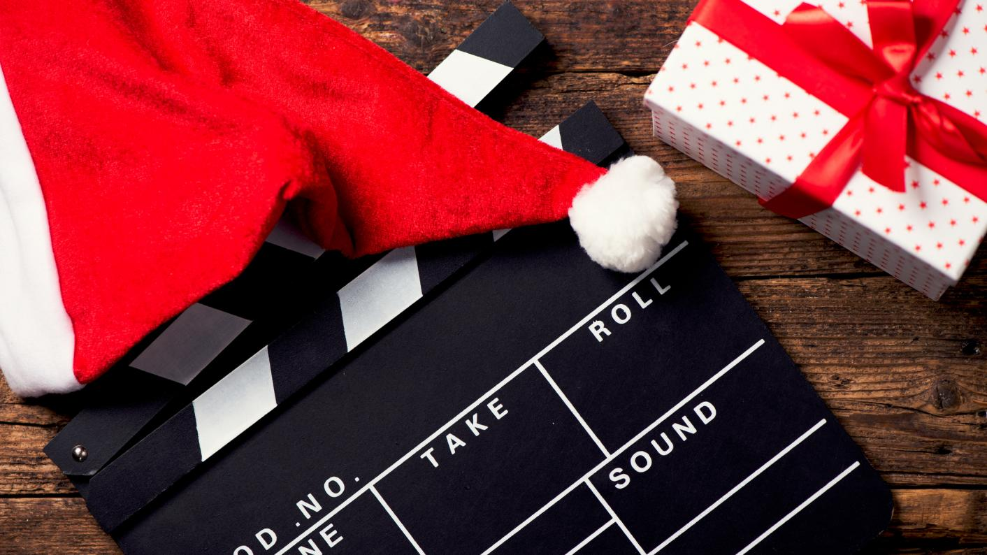 Film clapper board with Santa hat and present