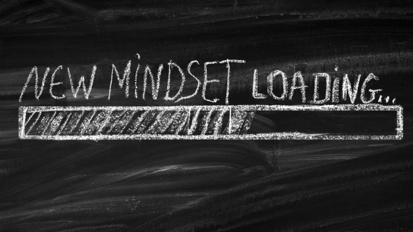 Chalk on blackboard reading 'New Mindset Loading' in imitation of computer screen
