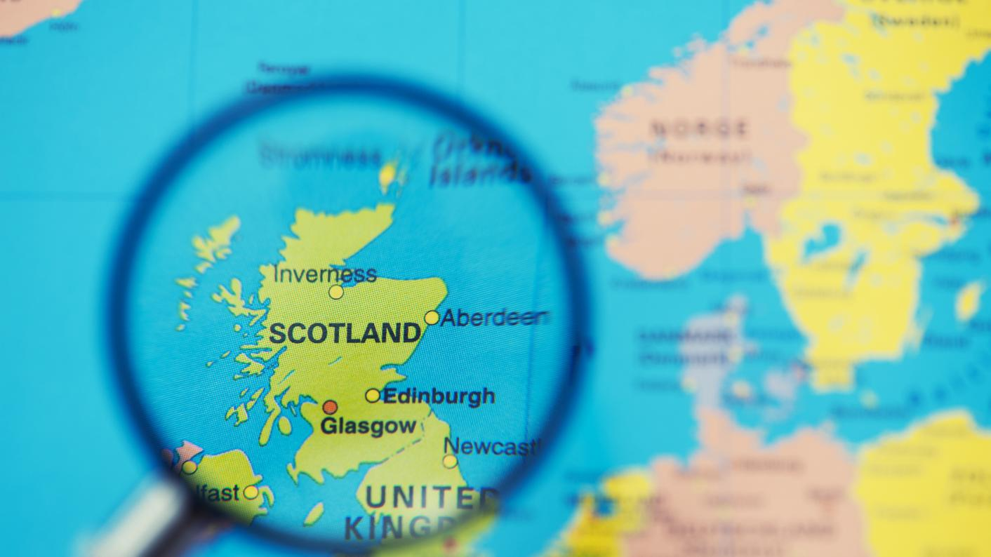 Map with Scotland viewed through magnifying glass