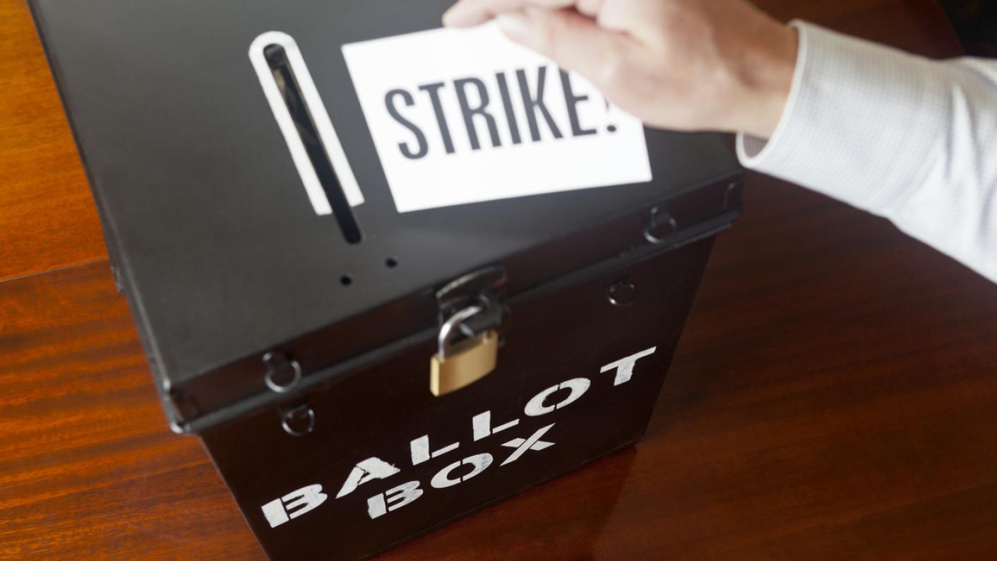 """Ballot box, with paper marked """"strike"""""""