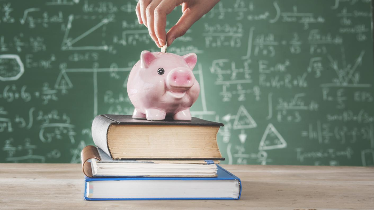 piggy-bank on books