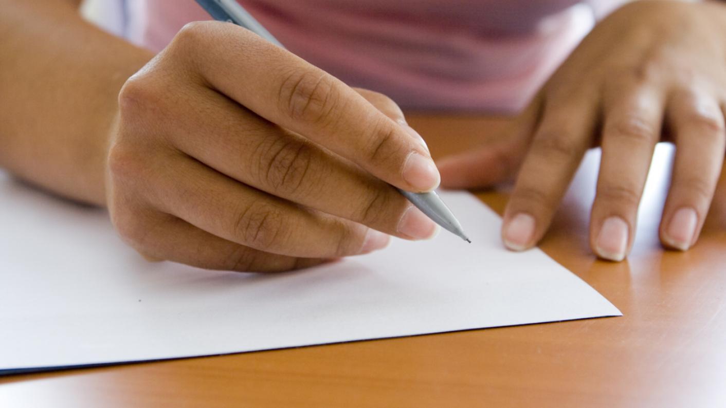 Woman prepares to write letter