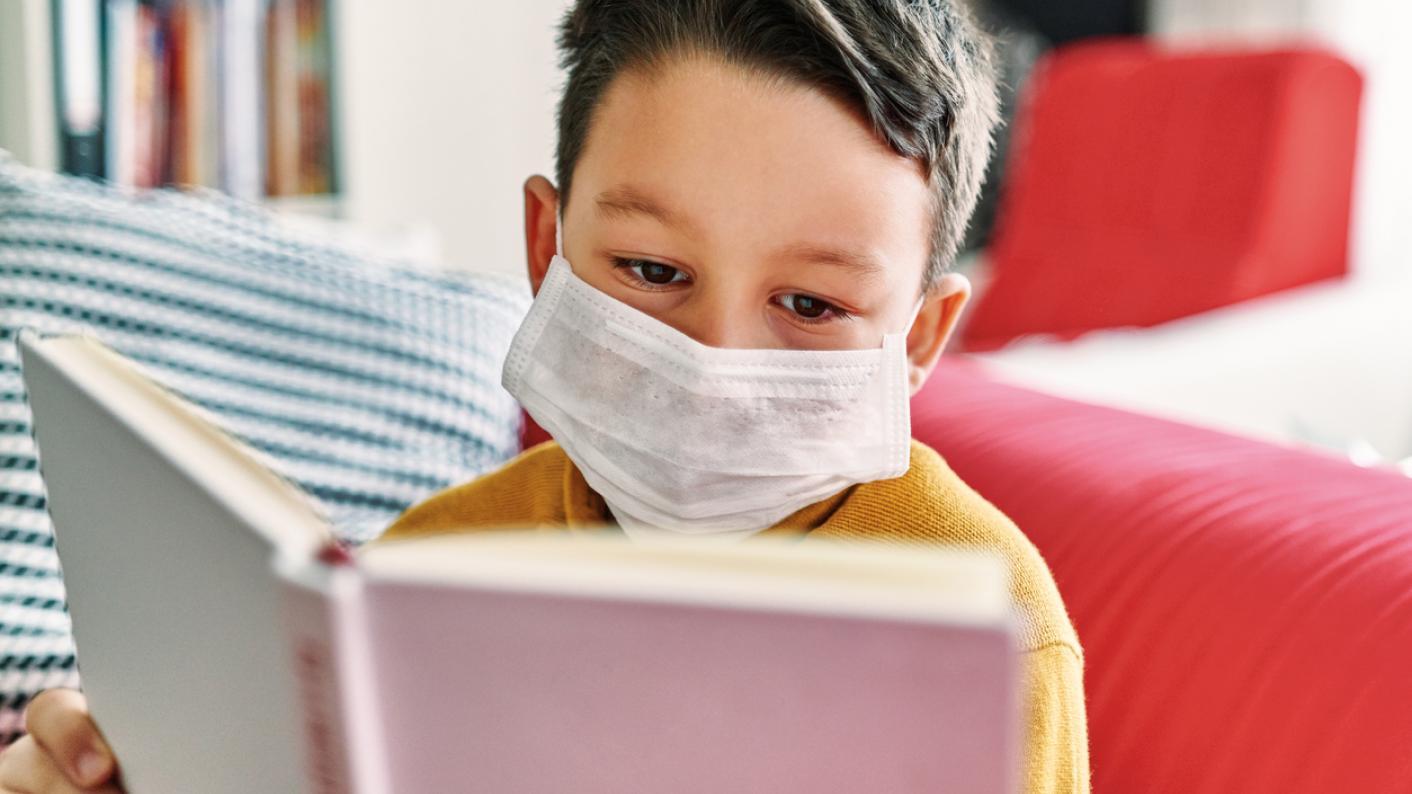 Coronavirus: Pupil reading book at home