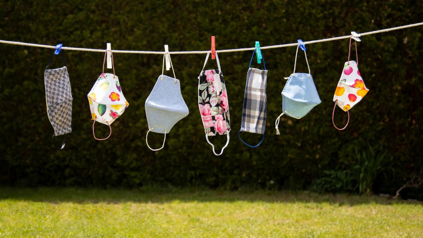 Patterned masks, hanging on a laundry line