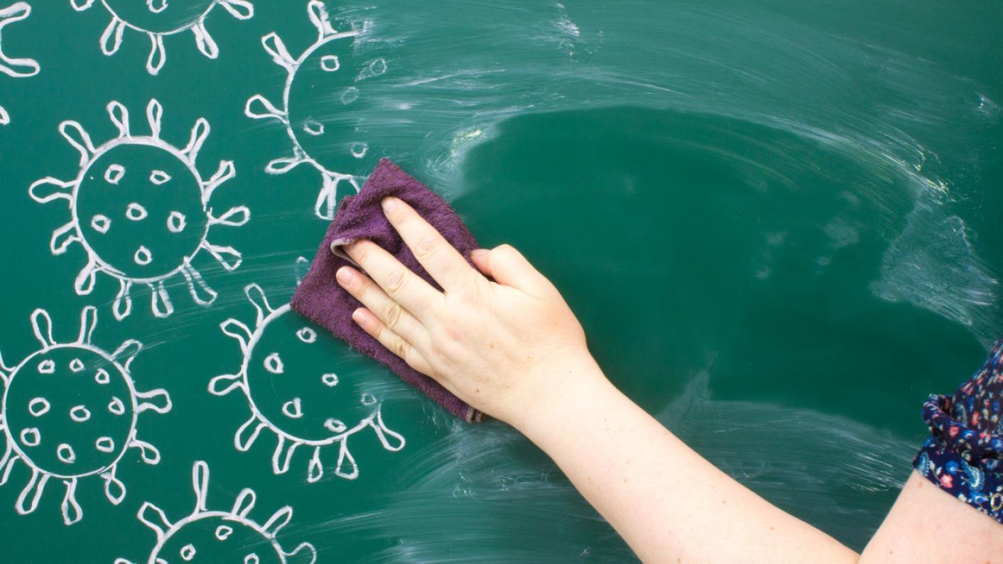 Teacher wipes drawing of coronavirus molecules off blackboard