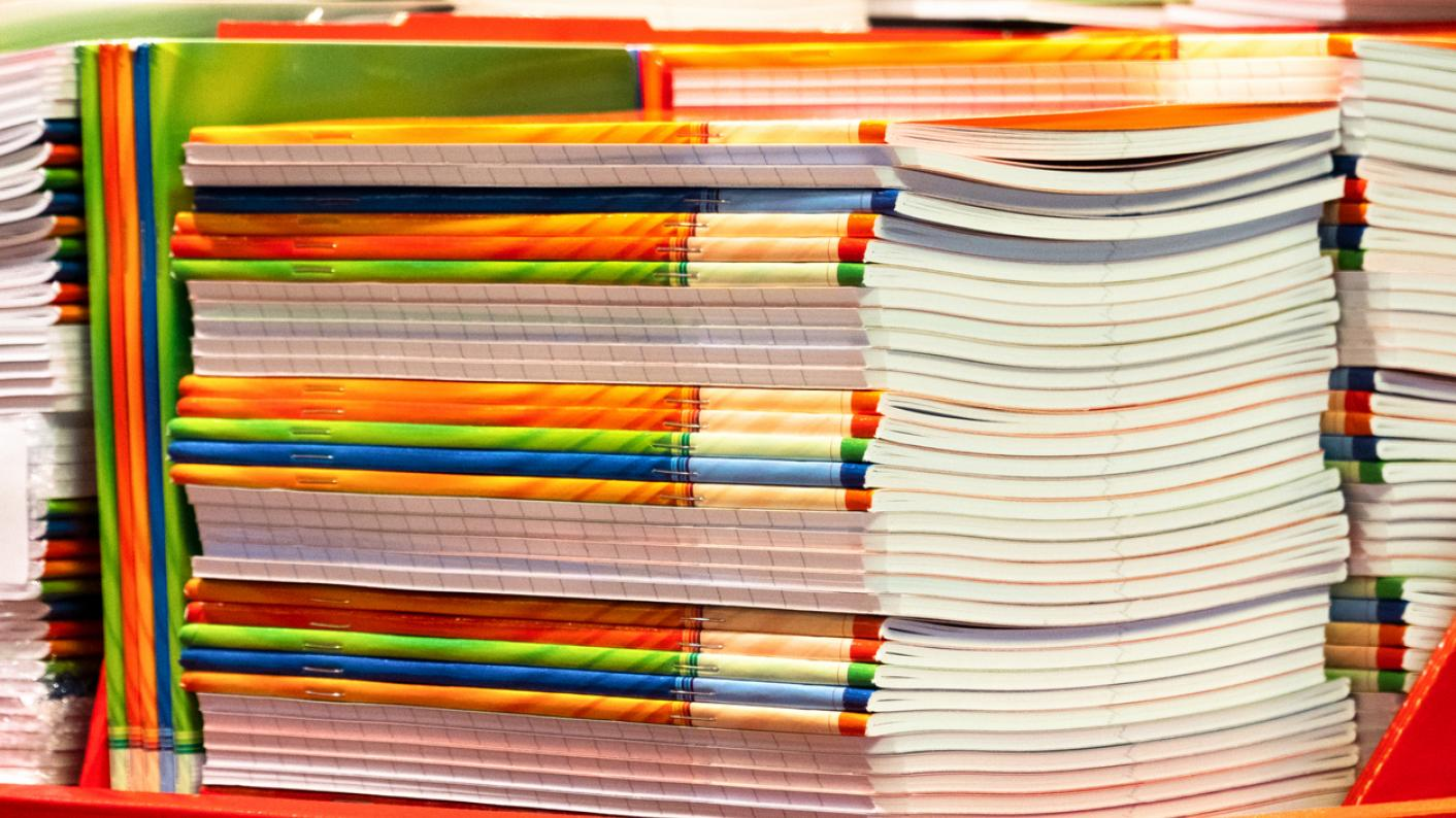 Large pile of exercise books