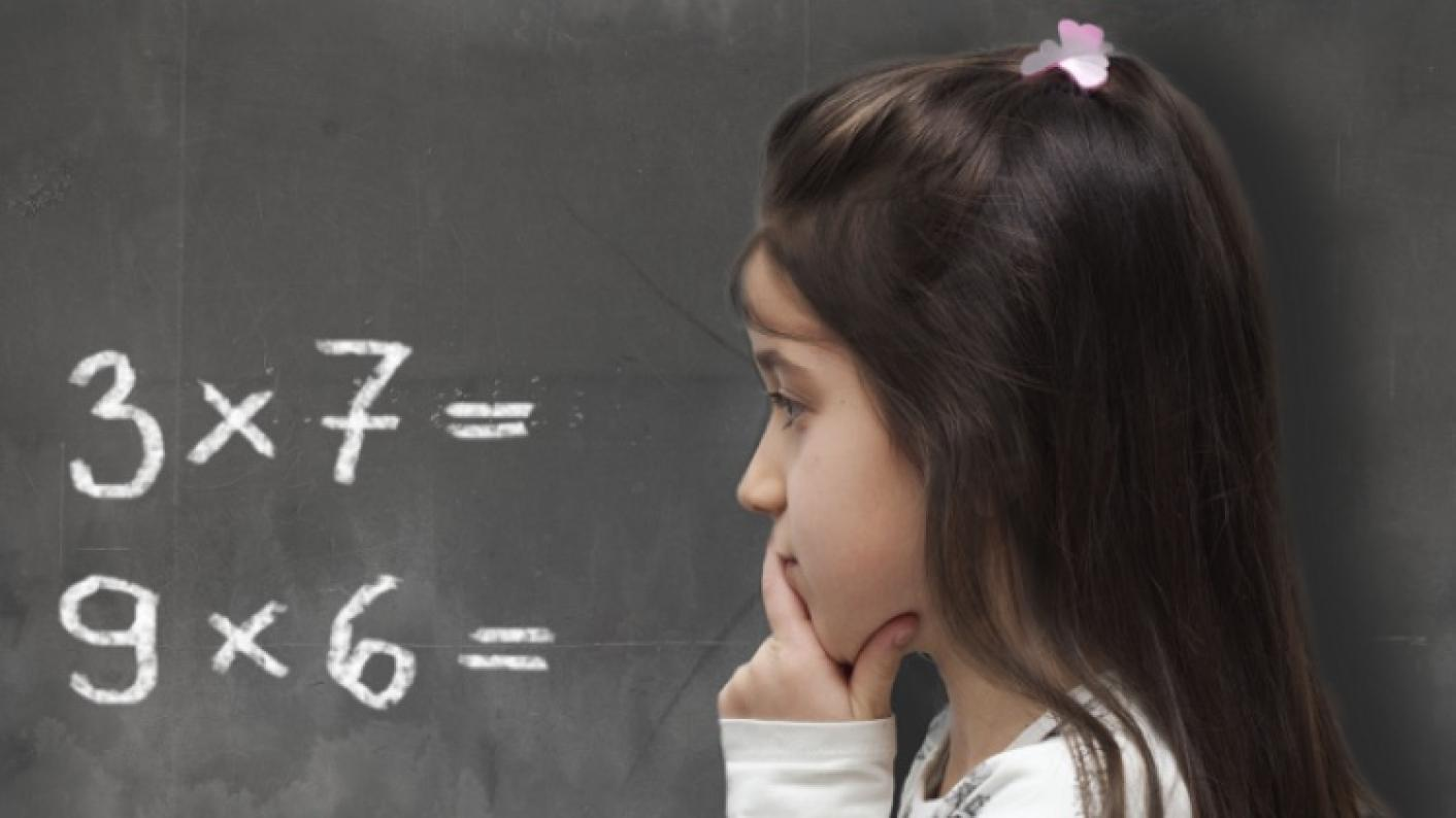 Girl Looking At Maths Multiplication & Division Question On The Board