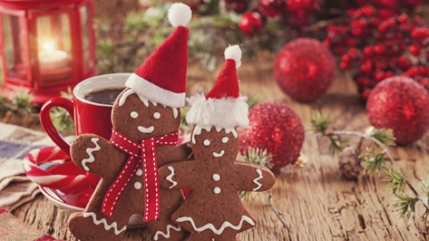 Gingerbread Man & Woman With Santa Hats Reflecting Festive Classroom Activities For EYFS & Primary Pupils