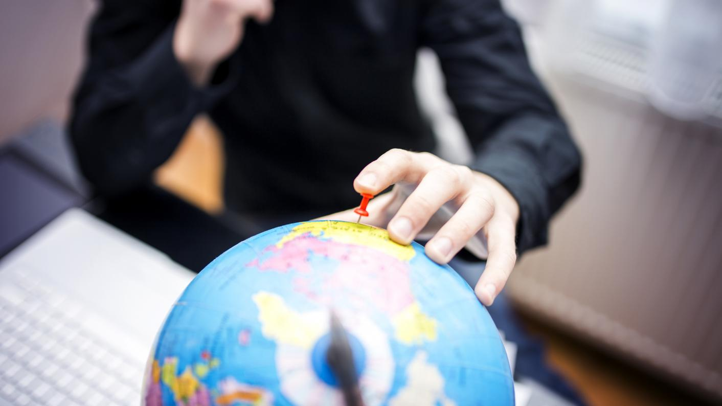 Teacher looking at globe