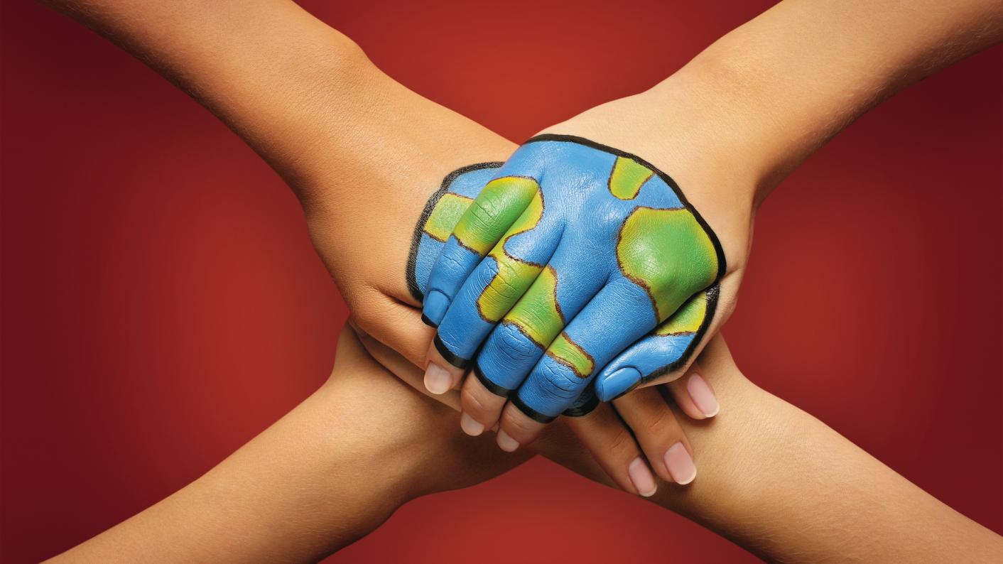 Students hands joined together painted with a world. Climate change resources for secondary students