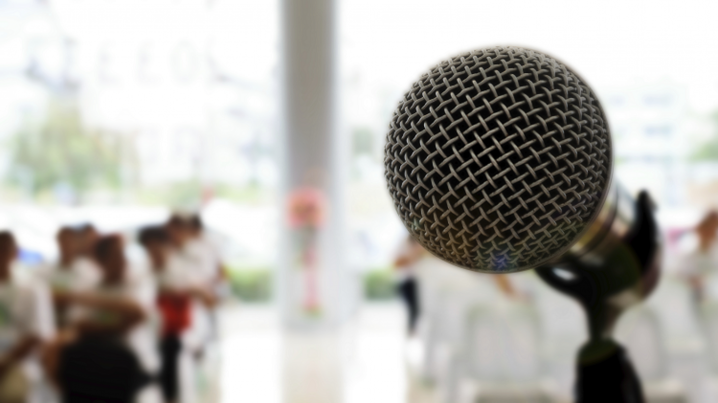 Microphone in front of a crowd; debates and speeches resources