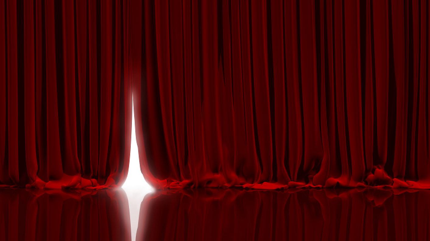 Large red curtains to signify celebration of the end of year 6