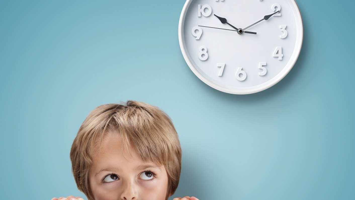 Boy Looking Up At The Time To Check He Is On Schedule For His Daily Routine