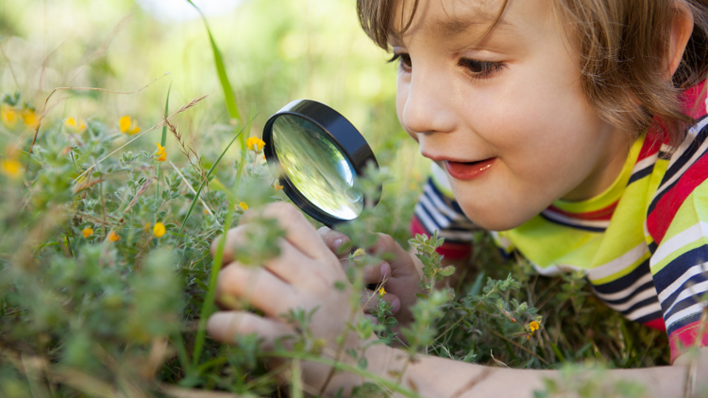 Child Taking Part In Outdoor Learning Activity Resource