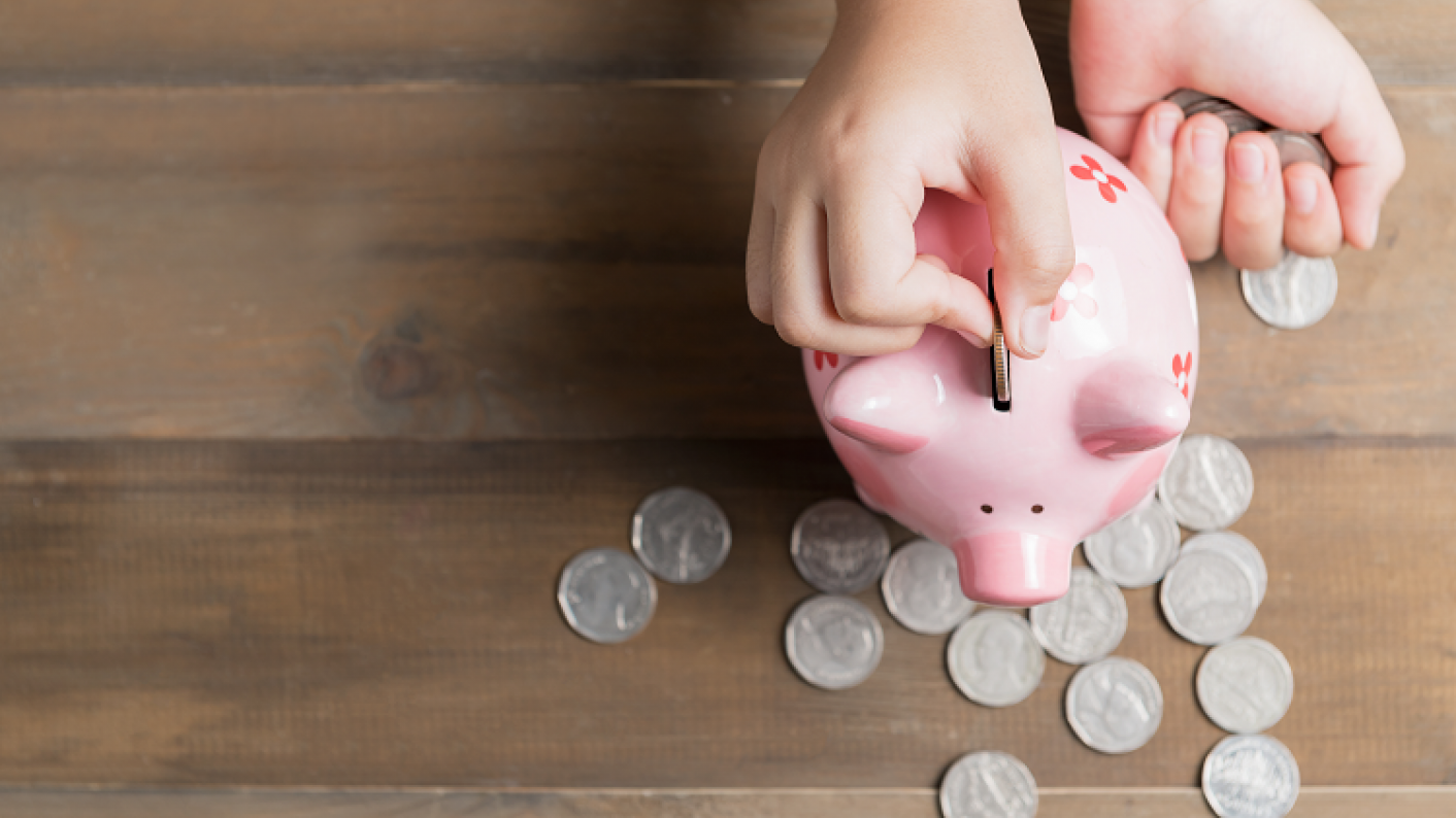 Child Saving Using A Piggy Bank Representing Primary Maths Lessons About Money, Coins, Notes, Pounds & Pence
