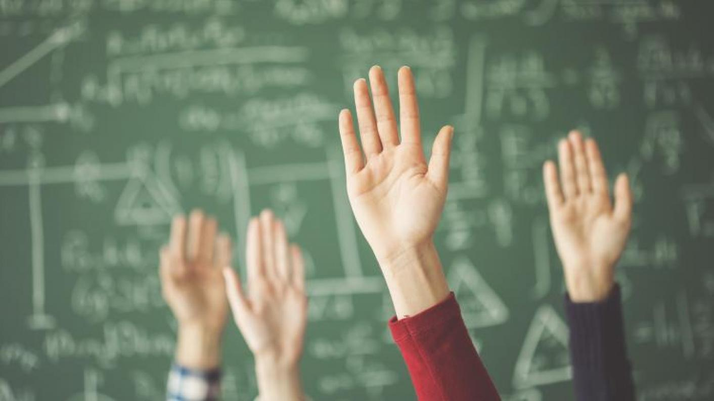 hands up in a classroom engaging in starters and plenaries